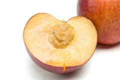 Nectarine half Stock Images