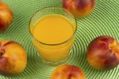 Nectarine juice and fresh nectarine Royalty Free Stock Image
