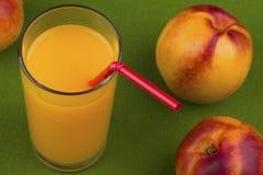 Nectarine juice Stock Images