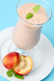 Nectarine milk shake Stock Images