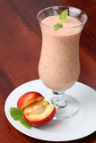 Nectarine milk shake Stock Photo