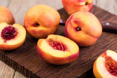 Nectarine. Fruit on a wooden Royalty Free Stock Photography