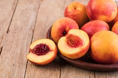 Nectarine. Fruit on a wooden royalty free stock photo