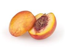Nectarine op wit stock foto's