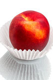 Nectarine in a paper vase Royalty Free Stock Image
