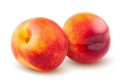 Nectarine or peach isolated on white background, clipping path, full depth of field. Yellow ripe food red fruit raw healthy whole juicy sweet orange fresh stock photo