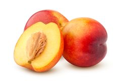 Nectarine or peach  on white background, clipping path, full depth of field. Yellow ripe food red fruit raw healthy whole juicy sweet orange fresh organic stock images