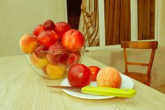 Nectarine, peaches and plums with water drops on wood table. fru Stock Images