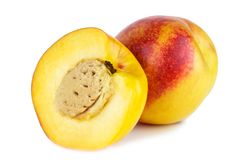 Nectarine with slice isolated on Royalty Free Stock Photos