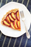 Nectarine tart on a white plate Royalty Free Stock Images