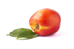 Nectarine whole with two leaves isolated Stock Images
