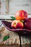 Nectarine in a wicker plate. Royalty Free Stock Photography