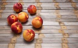Nectarine Wood Background Stock Photo