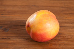 Nectarine on wood Royalty Free Stock Photo