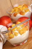 Nectarine and yoghurt in a glass. Some fresh organic nectarine and yoghurt in a glass Royalty Free Stock Photography