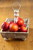 Nectarines. Ripe nectarines waiting to be eaten in a wooden basket Royalty Free Stock Photo