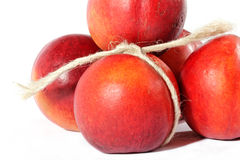 Nectarines. Some ripe peach with cord Royalty Free Stock Photo
