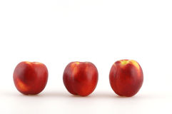 Nectarines. Three nectarines in front of a white background Stock Photography