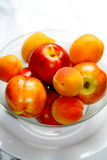 Nectarines and apricots. Freshly picked in a glass bowl Royalty Free Stock Images
