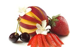 Nectarines, cherries and sliced strawberries. Sliced fresh fruit and seasonal flowers Stock Photo
