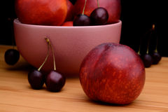 Nectarines and cherries on a wooden table Stock Image