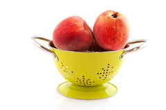 Nectarines in colander Royalty Free Stock Image