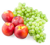 Nectarines and green grapes. On white background royalty free stock photography