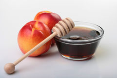 Nectarines and honey Royalty Free Stock Photography