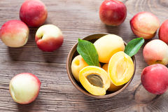 Nectarines, Peach and apricots on wooden table Royalty Free Stock Photo