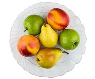 Nectarines, pears, apples in transparent dish isolated on white Stock Images