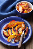Nectarines and plums in syrup Royalty Free Stock Photos