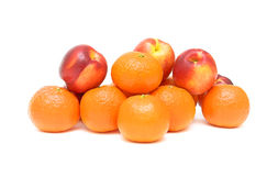 Nectarines and tangerines on a white background Royalty Free Stock Images