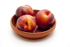 Nectarines in under plate Royalty Free Stock Images