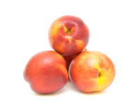 Nectarines on white background. Nectarines closeup isolated on white background Stock Image