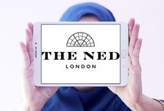 The ned hotel logo. Logo of the ned hotel on samsung tablet holded by arab muslim woman.  The Ned is a hotel & members club in the City of London with nine Stock Photography