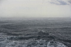Nederbörd på havet Royaltyfria Bilder