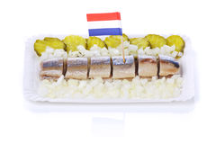 Nederlandse haringen ` die ` met uien en groenten in het zuur haring stock afbeeldingen