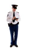 Nederlandse politieman die het parkeren kaartje invult. Stock Afbeeldingen