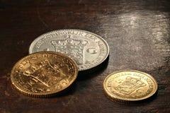 Nederlandse zilveren en gouden muntstukken Stock Foto