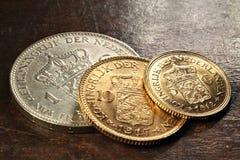 Nederlandse zilveren en gouden muntstukken Stock Afbeelding