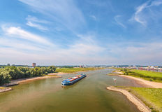 The Nederrijn river in front of the Dutch city of Arnhem Royalty Free Stock Photos