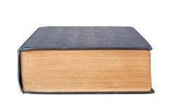 Nedersta kant av en bok Arkivbild