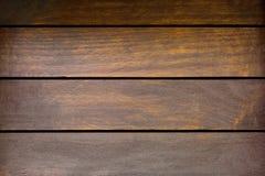 Nedfläckad brun träbakgrund, gamla lantliga wood plankor på svart Arkivbilder