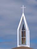 nedfläckad kyrktorn för exponeringsglas Royaltyfri Bild