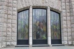 nedfläckada utsiktfönster för hus Arkivfoto