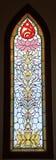nedfläckadt fönster buddha för färgrikt exponeringsglas Arkivfoto