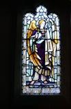nedfläckadt fönster för kyrkligt exponeringsglas Arkivfoton