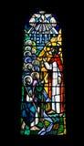 nedfläckadt fönster för glass klosterbroder Arkivbild
