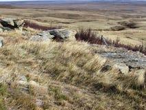 Nedgångprärien på Huvud-Slå-i buffeln hoppar Arkivfoton