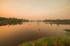 Nedgångreflexioner i vatten Fotografering för Bildbyråer